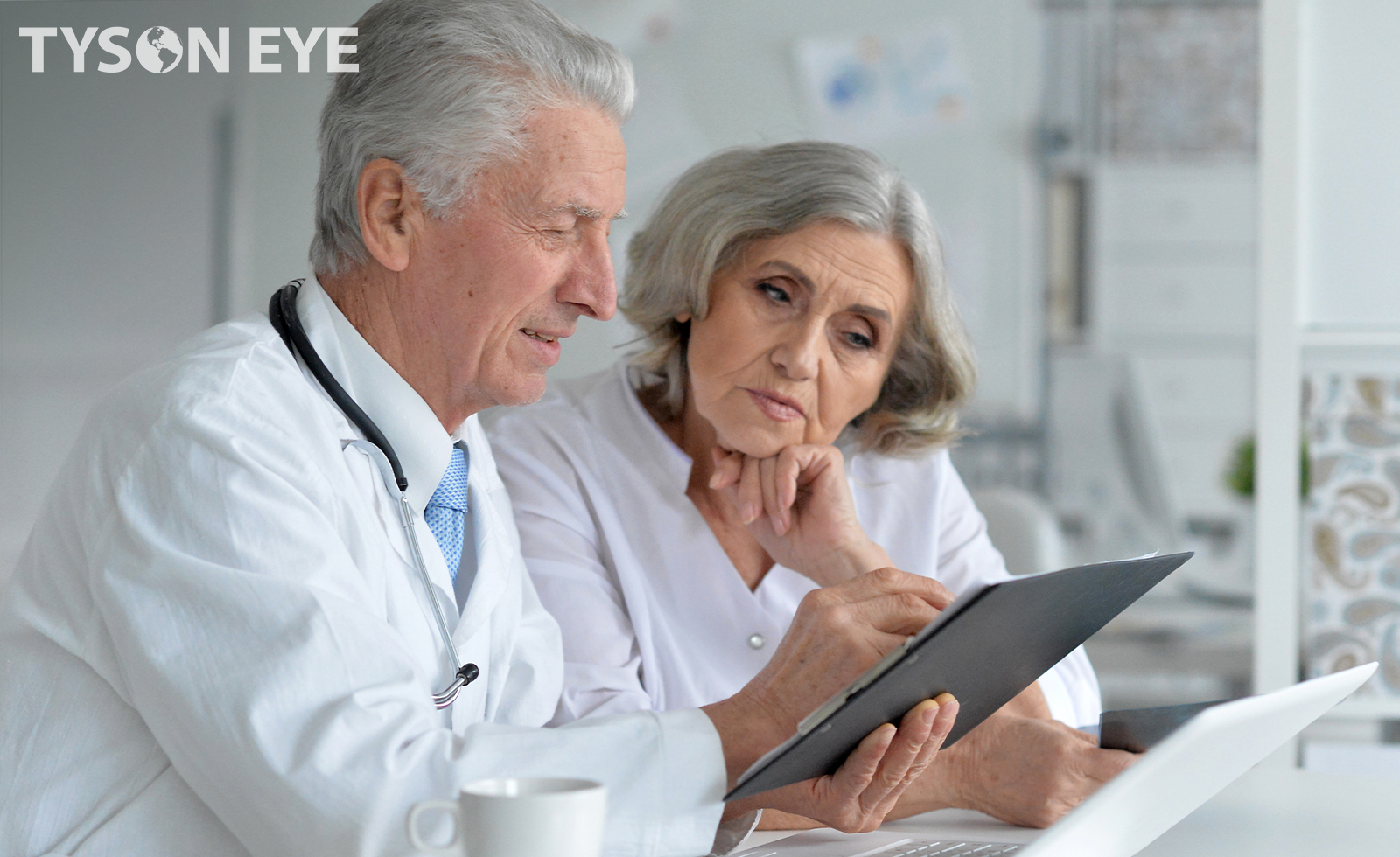Male optometrist discussing Cataract IOL Options for surgery with female senior